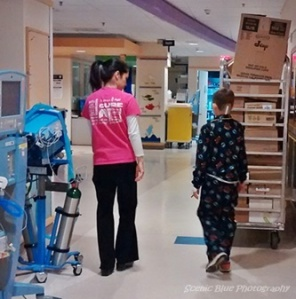 Luke walking the PICU on the morning after surgery.